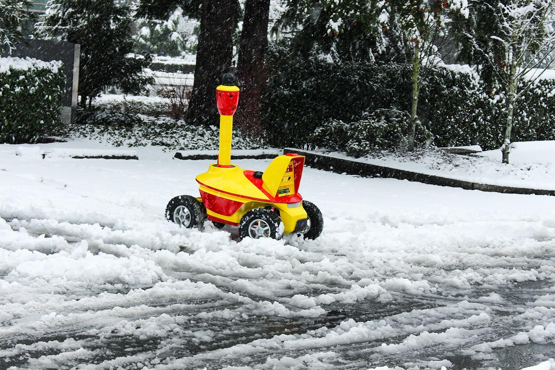 Security Robot Drive Through A Snow Drift