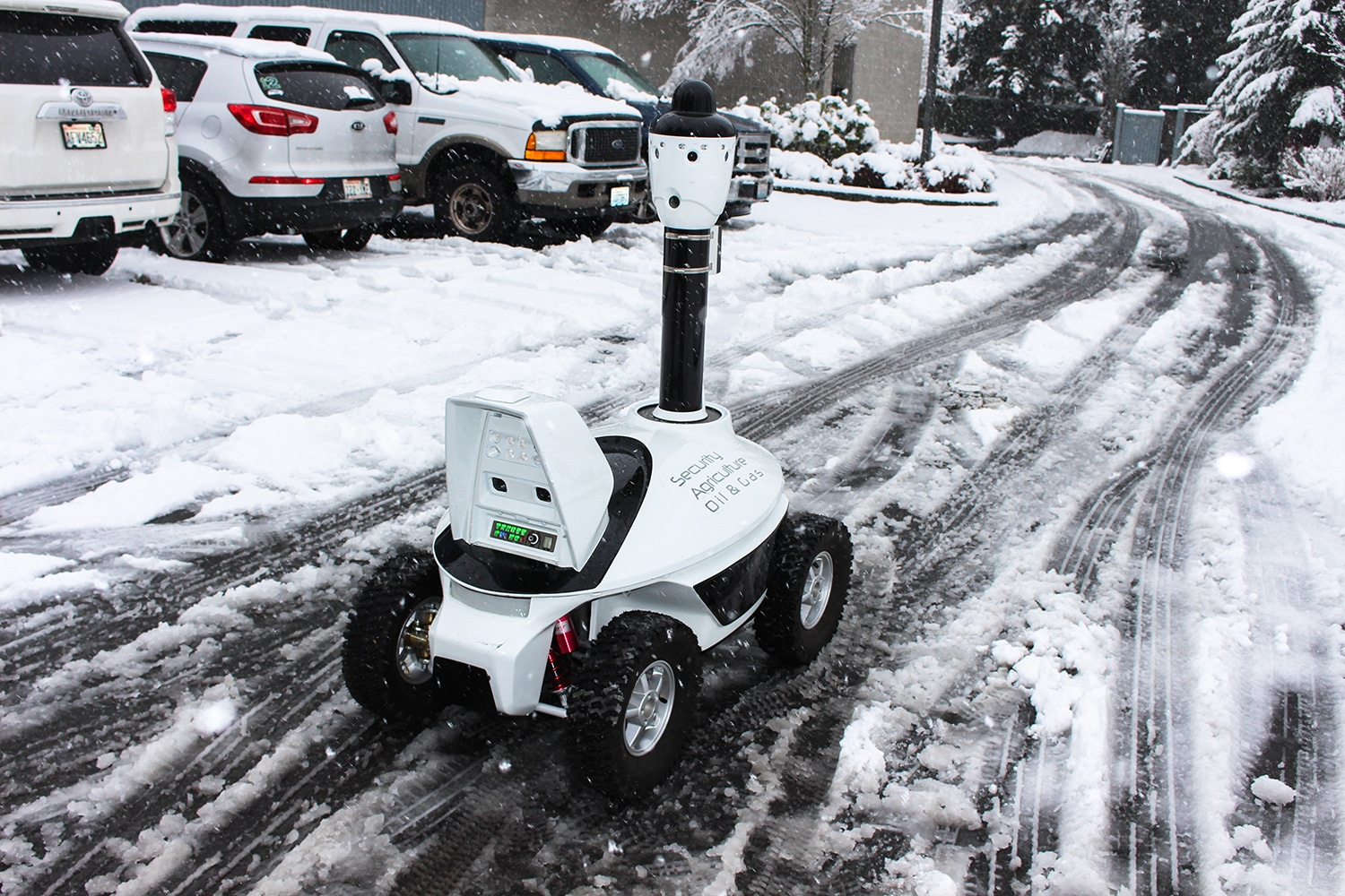 Security robot moving on the slippery road